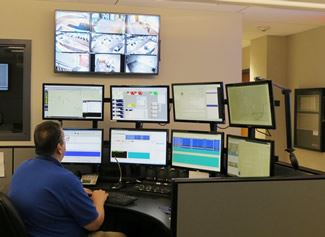Communications Employee Viewing Monitors